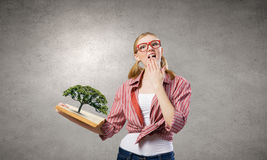 Girl excited with book Royalty Free Stock Photos