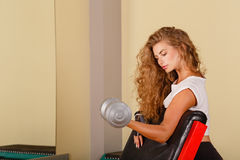 Girl exercise biceps with hand weights Royalty Free Stock Photo