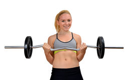 Girl exercise biceps muscles with dumbbell Royalty Free Stock Image