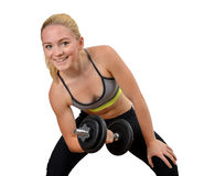 Girl exercise biceps muscles with dumbbells Stock Photos