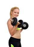 Girl exercise biceps muscles with dumbbells Royalty Free Stock Images