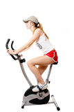 The girl on exercise bicycle