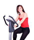 Girl exercise. With fitness cross trainer Stock Image