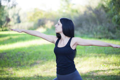 Girl exercise in nature Royalty Free Stock Image