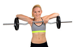 Girl exercise shoulder muscles with dumbbell. On white background stock images