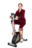 Girl exercise on spinning bicycle Stock Images