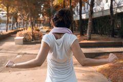 Girl exercise and stretch body at autumn park Stock Image