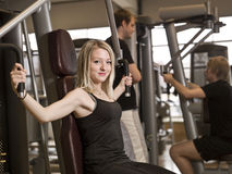 Girl exercising Stock Images
