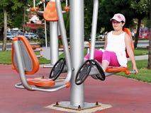 Girl exercising. On exercise equipment Royalty Free Stock Photo