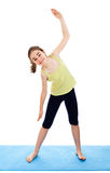 Girl exercising. Active girl exercising isolated on white background Royalty Free Stock Photo