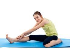 Girl exercising. Active girl exercising isolated on white background Stock Image