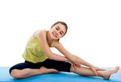 Girl exercising. Active girl exercising isolated on white background Stock Photos