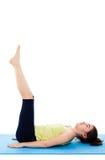 Girl exercising. Active girl exercising isolated on white background Royalty Free Stock Images
