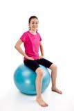 Girl exercising. Using ball on white background Royalty Free Stock Photography