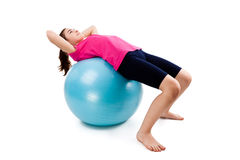 Girl exercising. Using ball on white background Royalty Free Stock Images