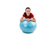 Girl exercising. Using ball on white background Stock Photos