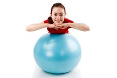 Girl exercising. Using ball on white background Royalty Free Stock Photo