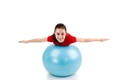 Girl exercising. Using ball on white background Royalty Free Stock Photos