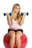Girl Exercising. Isolated pretty teen girl exercising Royalty Free Stock Photos