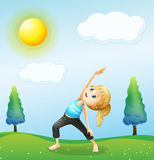 A girl exercising above the hills Royalty Free Stock Images