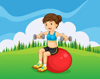 A girl exercising with a barbell and a bouncing ball Royalty Free Stock Photography