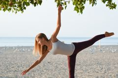 Girl exercising at the beach Royalty Free Stock Image