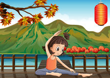 A girl exercising at the bridge with a lantern Royalty Free Stock Photos