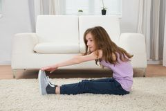 Girl Exercising On Carpet royalty free stock photography