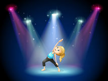 A girl exercising at the center of the stage Stock Images