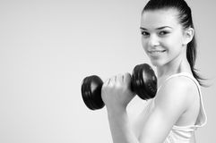 Girl exercising with dumbbell Stock Photography