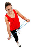Girl exercising with elastic fitness band Stock Photos