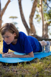 Girl exercising on exercise mat during obstacle course training Royalty Free Stock Photo