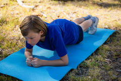 Girl exercising on exercise mat during obstacle course training Royalty Free Stock Photos