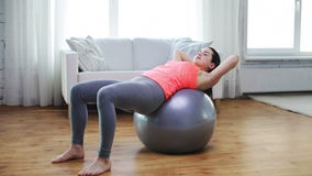 Girl exercising with fitness ball at home stock video