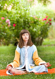 Girl exercising in garden Royalty Free Stock Photos