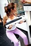 Girl exercising at the gym Royalty Free Stock Images