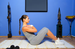 Girl exercising at home Stock Photos