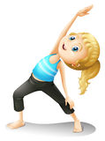 A girl exercising Stock Images