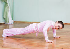 Girl exercising indoor Royalty Free Stock Image