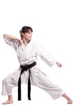 Girl exercising karate. Against white background Royalty Free Stock Image