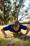 Girl exercising during obstacle course training Royalty Free Stock Photography