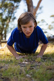Girl exercising during obstacle course training Royalty Free Stock Image