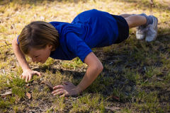 Girl exercising during obstacle course training Royalty Free Stock Images