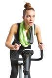 Girl Exercising On Exercise Bike Stock Images