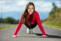 Girl exercising outdoor Royalty Free Stock Photo