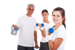 Girl exercising parents Stock Images