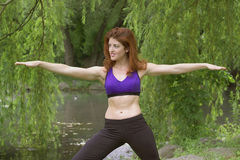 Girl exercising in park. Girl exercising in Central Park New York.  She was 26 at the time of shoot and Jewish American.  Photographed June, 2007 in the USA Stock Image
