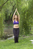 Girl exercising in park. Girl exercising in Central Park New York.  She was 26 at the time of shoot and Jewish American.  Photographed June, 2007 in the USA Royalty Free Stock Photo