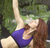 Girl exercising in park. Girl exercising in Central Park New York.  She was 26 at the time of shoot and Jewish American.  Photographed June, 2007 in the USA Stock Photo
