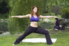 Girl exercising in park. Girl exercising in Central Park New York.  She was 26 at the time of shoot and has signed a release.  Photographed June, 2007 Stock Photo